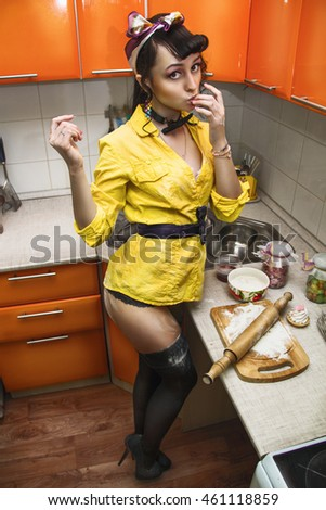 sexy girl in lingerie in the kitchen preparing food