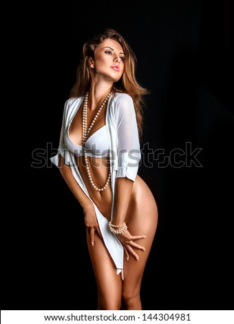 Sexy girl in lingerie on black background in studio - stock photo