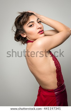 Sexy girl in red dress from behind