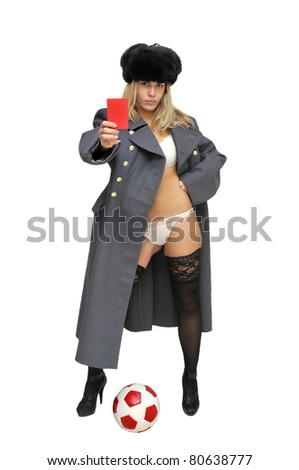 Sexy girl in russian army greatcoat  holding a soccer ball and a red card isolated in white - stock photo