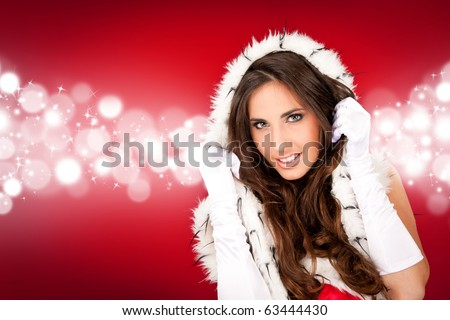 sexy girl in santa costume on abstract shiny  background - stock photo