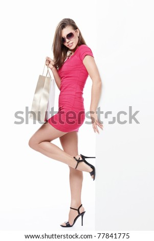 Sexy girl in sunglasses with a bag isolated