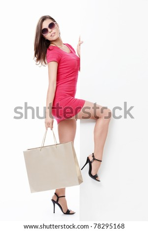 Sexy girl in sunglasses with a bag isolated - stock photo