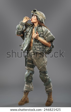 """Sexy girl in the form of a soldier of the American division. Operation �¢??Desert Storm"""" - stock photo"""