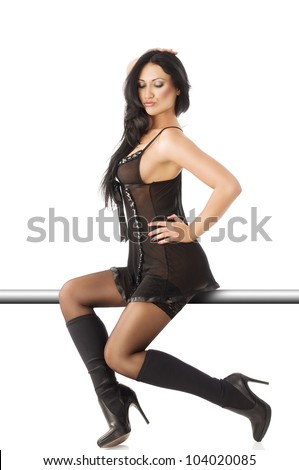 sexy girl in transparent lingerie with black stockings and boots, she is sitting on a stull, turned in profile, looks down and has the left hand on a hip.