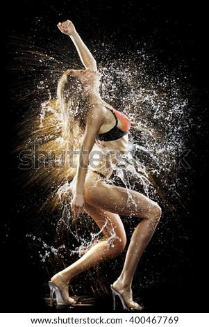 Sexy girl in water splash - stock photo