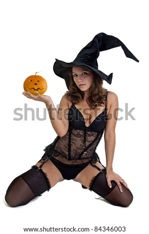 Sexy girl in witch costume isolated in white - stock photo