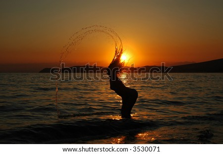 Sexy girl making a spectacular water effect - stock photo
