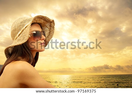 Sexy girl on the beach during sunset - stock photo