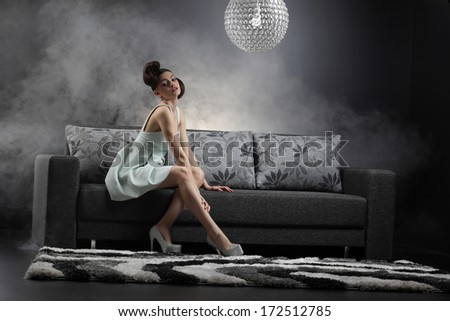 sexy girl on the couch.Fashion photo  - stock photo