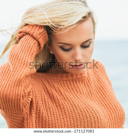 sexy girl poses on a beach. beautiful blonde enjoys walk on the coast. Photo with instagram style filters - stock photo