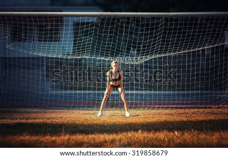 Sexy girl posing at the stadium - stock photo