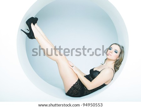 sexy girl sitting in a circle - stock photo