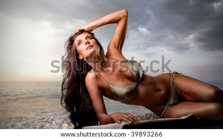 sexy girl tanning on the beach - stock photo