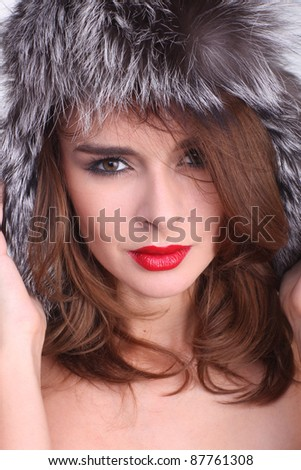 Sexy girl wearing a hat made of fur.