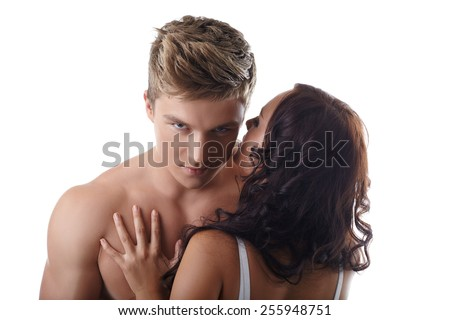 Sexy girl whispers in ear of handsome guy - stock photo