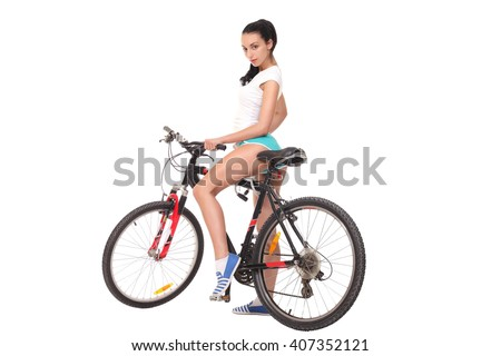 sexy girl with a bike on a white background - stock photo