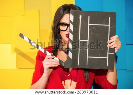 Sexy girl with a cracker for the movie. On the neck of the bulb fetish - games.  - stock photo