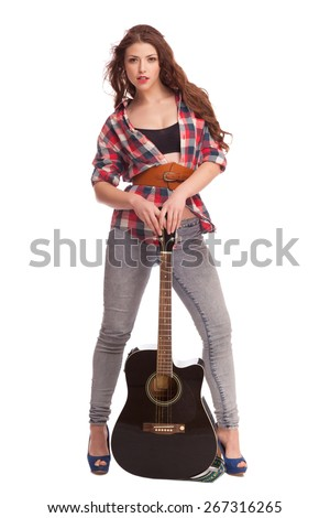 Sexy girl with a guitar. Play and pose and dance with guitar. Isolated on white