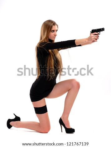 Sexy girl with a pistol on a white background