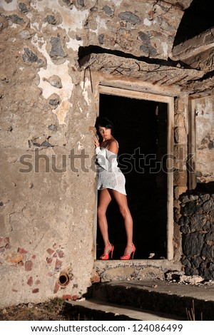 sexy girl with beautiful legs in the old house at night - stock photo