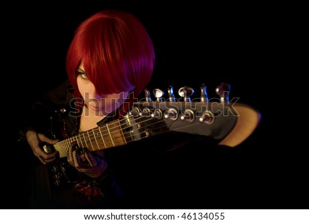 Sexy girl with guitar, selective focus on face, high angle view
