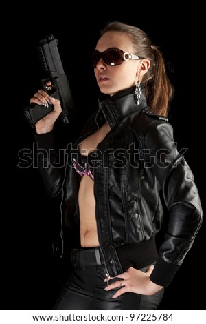 Sexy girl with gun. Isolated on Black - stock photo
