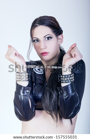 sexy girl with handcuffs - stock photo