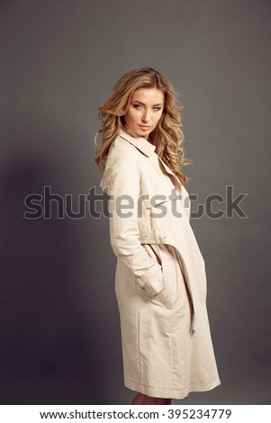 sexy girl with long blond hair in beige fur coat