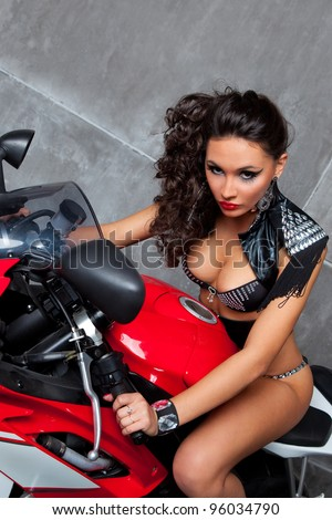 Sexy girl  with perfect body on red sportbike - stock photo