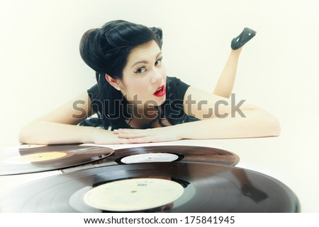 Sexy girl with phonography analogue record music lover studio shot