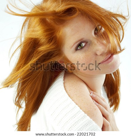 Sexy girl with red hair and freckles posing on white studio background - stock photo