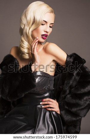 sexy glamour blond woman in black fur coat - stock photo