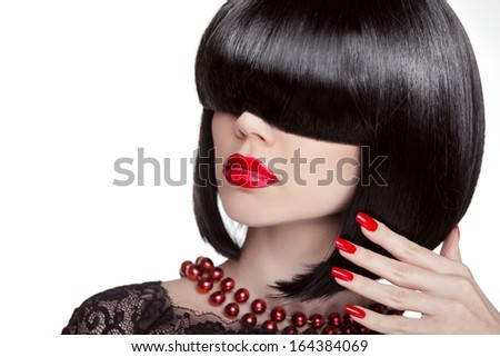 Sexy Glamour Girl. Fashion portrait of brunette woman with black hair showing red manicured polish nails and hot lips. Professional makeup and hairstyle. Model isolated on white background. - stock photo