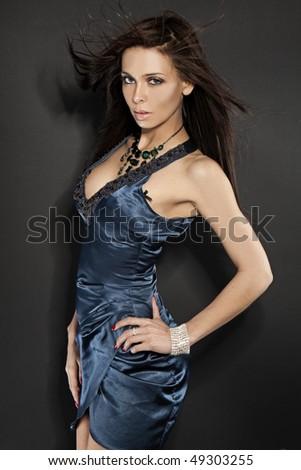 sexy glamour model wearing blue dress - stock photo