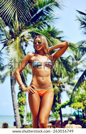 Sexy gorgeous blonde woman in bikini. Fashion female model posing outdoor - stock photo