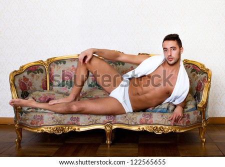 sexy guy relaxed in living room