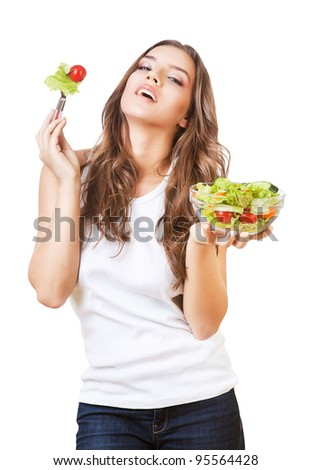 sexy happy girl in white t-shirt with salad on white background - stock photo