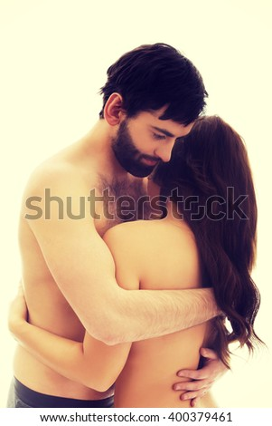 Sexy heterosexual couple embracing. - stock photo