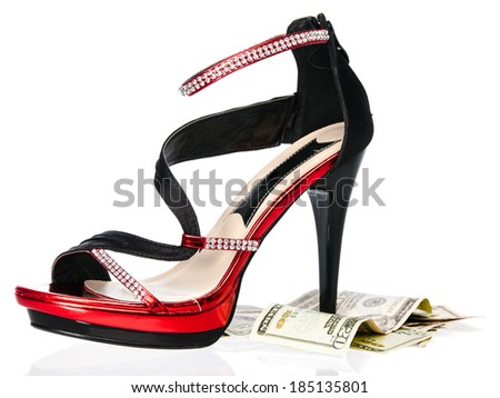 Sexy high heels over u.s. money isolated on white background - stock photo