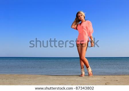 sexy hot brunette bikini model on the beach - stock photo