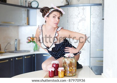 Sexy housewife in the kitchen - stock photo