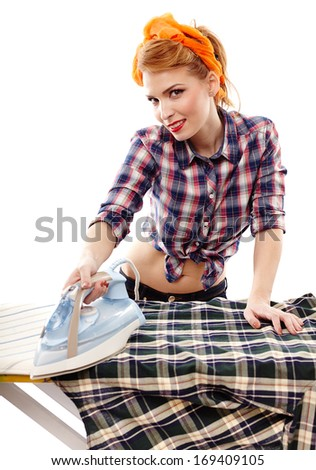 Sexy housewife ironing, isolated over white background - stock photo