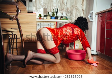 Sexy housewife washes floor in the kitchen, similar available in my portfolio - stock photo