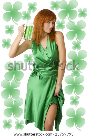 Sexy Irish Lass posing in green dress drinking green beer