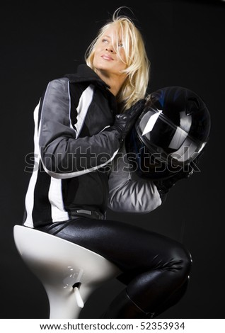 Sexy is holding helmet and posing