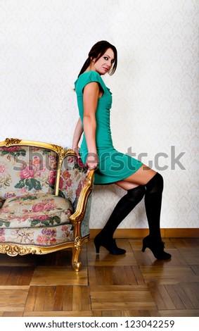 sexy italian woman in living room - stock photo