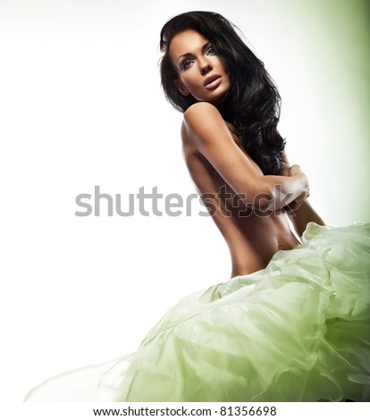 Sexy lady hiding her brest - stock photo