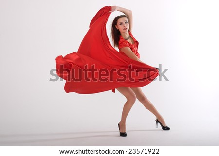 sexy lady in red dress in studio is dancing - stock photo