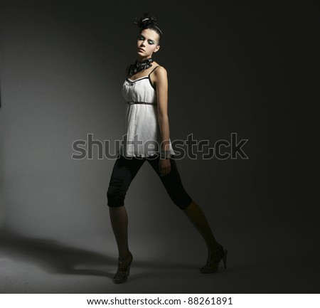Sexy lady in white dress isolated on dark background